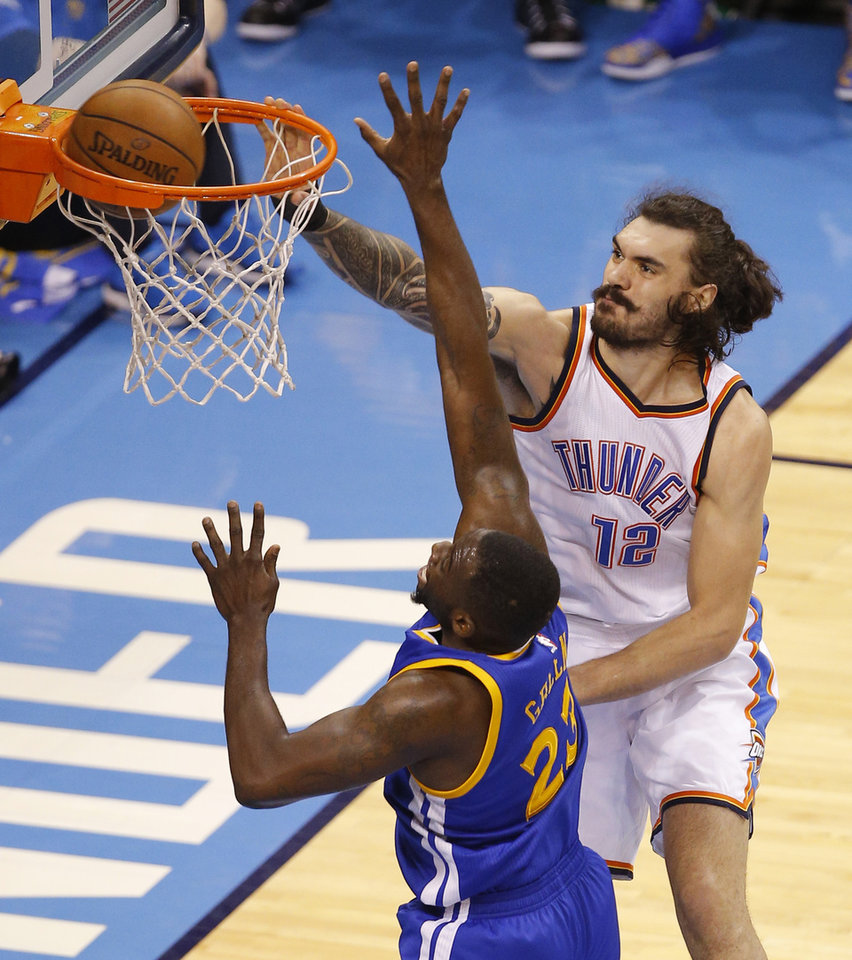 Photo - Oklahoma City's Steven Adams (12) dunks over Golden State's Draymond Green (23) during Game 6 of the Western Conference finals in the NBA playoffs between the Oklahoma City Thunder and the Golden State Warriors at Chesapeake Energy Arena in Oklahoma City, Saturday, May 28, 2016. Photo by Bryan Terry, The Oklahoman