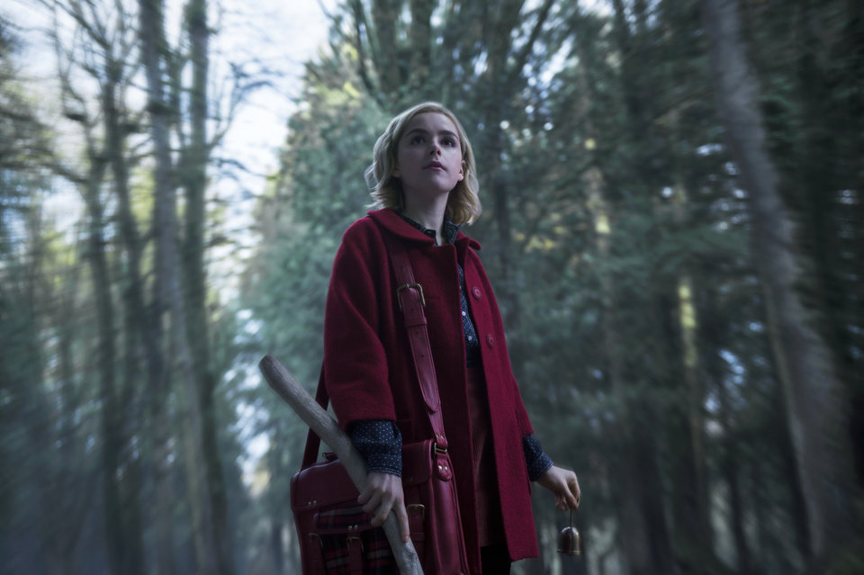 Photo -  Kiernan Shipka stars as Sabrina Spellman. [Photo by Diyah Pera, Netflix]
