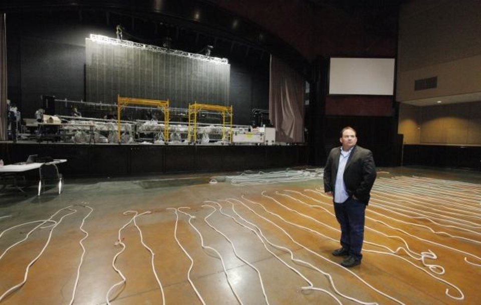 Photo -  Brent Brewer, Brewer Entertainment, is shown on the seating floor at the Bricktown Events Center as a concert is being set up in this 2014 photo. [THE OKLAHOMAN ARCHIVES]