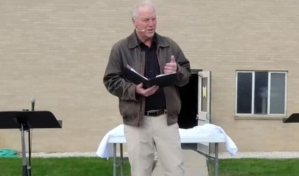 Photo -  In this Oct. 11 photo taken from video and provided by Wayne Bakker, former pastor of East Saugatuck Christian Reformed Church, Keith Mannes, leads an outdoor service via Facebook Live in Holland, Mich. Mannes stepped aside from his pastoral role at the church earlier in October after three decades of ministry, saying he loved his church but felt alienated from the broader institution. [Provided/Wayne Bakker/via AP]