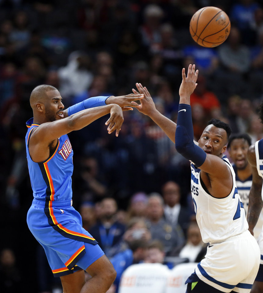 Photo - Oklahoma City's Chris Paul (3) passes away from Minnesota's Josh Okogie (20) during an NBA basketball game between the Minnesota Timberwolves and the Oklahoma City Thunder at Chesapeake Energy Arena in Oklahoma City, Friday, Dec. 6, 2019. Oklahoma City won 139-127 in overtime. [Nate Billings/The Oklahoman]