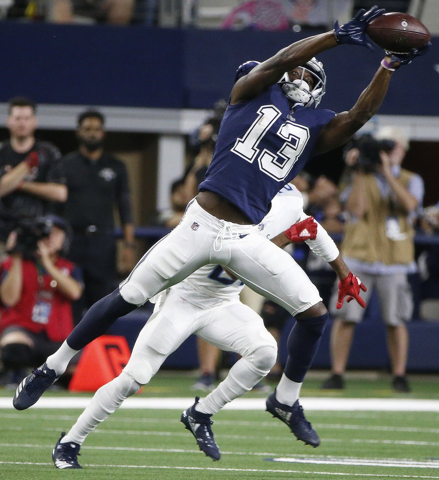 Dallas Cowboys wide receiver Michael Gallup (13) makes the catch against  the Tennessee Titans during the second half of an NFL football game 53dba4d70