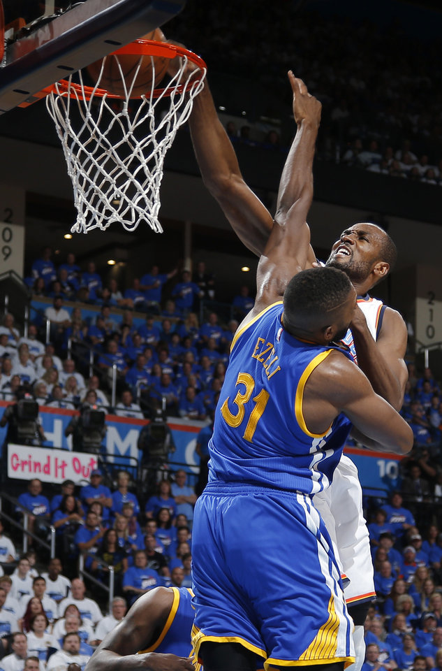 Photo - Oklahoma City's Serge Ibaka (9) dunks over Golden State's Festus Ezeli (31) during Game 3 of the Western Conference finals in the NBA playoffs between the Oklahoma City Thunder and the Golden State Warriors at Chesapeake Energy Arena in Oklahoma City, Sunday, May 22, 2016. Photo by Bryan Terry, The Oklahoman