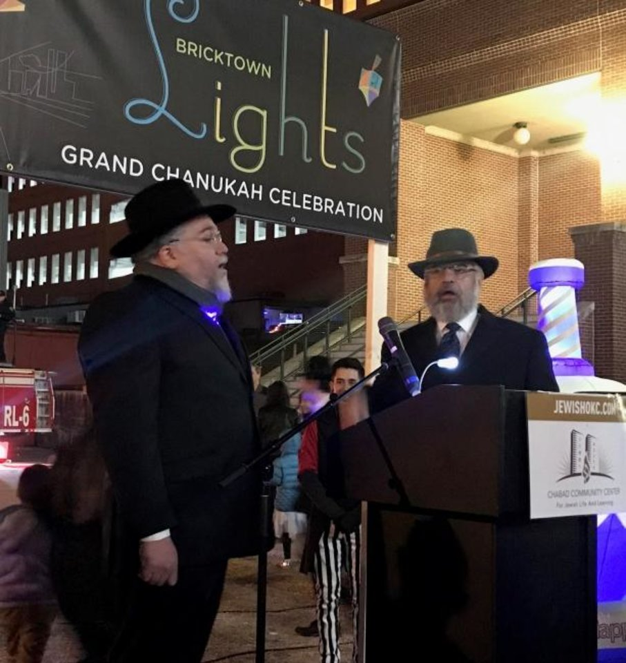 Photo -  Rabbi Ovadia Goldman, spiritual leader of the Chabad Community Center for Jewish Life and Learning, talks to the crowd at the  2018