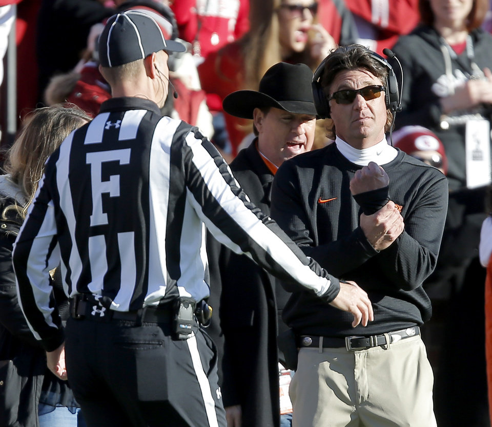 Photo - Oklahoma State's Mike Gundy gestures toward an official during a Bedlam college football game between the University of Oklahoma Sooners (OU) and the Oklahoma State University Cowboys (OSU) at Gaylord Family-Oklahoma Memorial Stadium in Norman, Okla., Nov. 10, 2018.  Photo by Bryan Terry, The Oklahoman