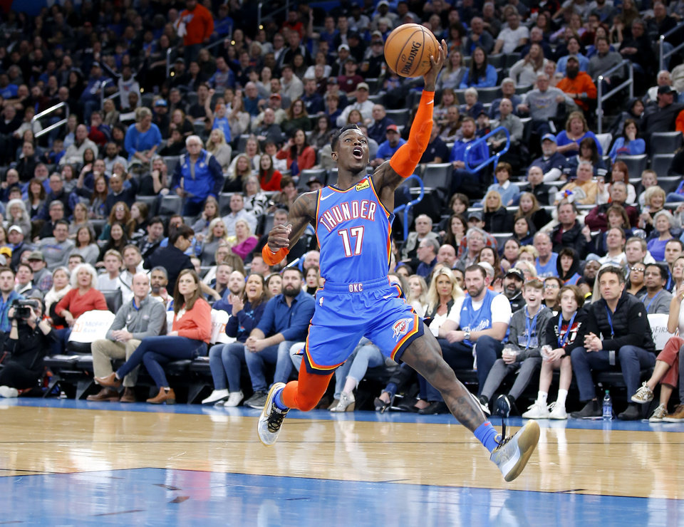 Photo - Oklahoma City's Dennis Schroder (17) goes up for a lay up during the NBA basketball game between the Oklahoma City Thunder and the Portland Trail Blazers at the Chesapeake Energy Arena in Oklahoma City, Saturday, Jan. 18, 2020.  [Sarah Phipps/The Oklahoman]