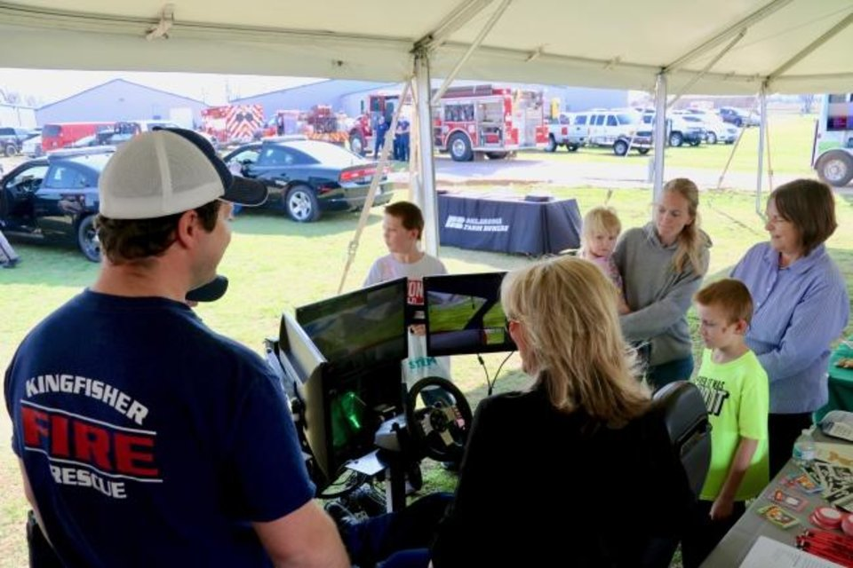 Photo -  Participants at the Oklahoma Energy Resources Board/Energize for Safety Coalition event held in Kingfisher this week check out a driving simulator. Organizers estimate about 700 people attended the event. [Oklahoma Energy Resources Board]