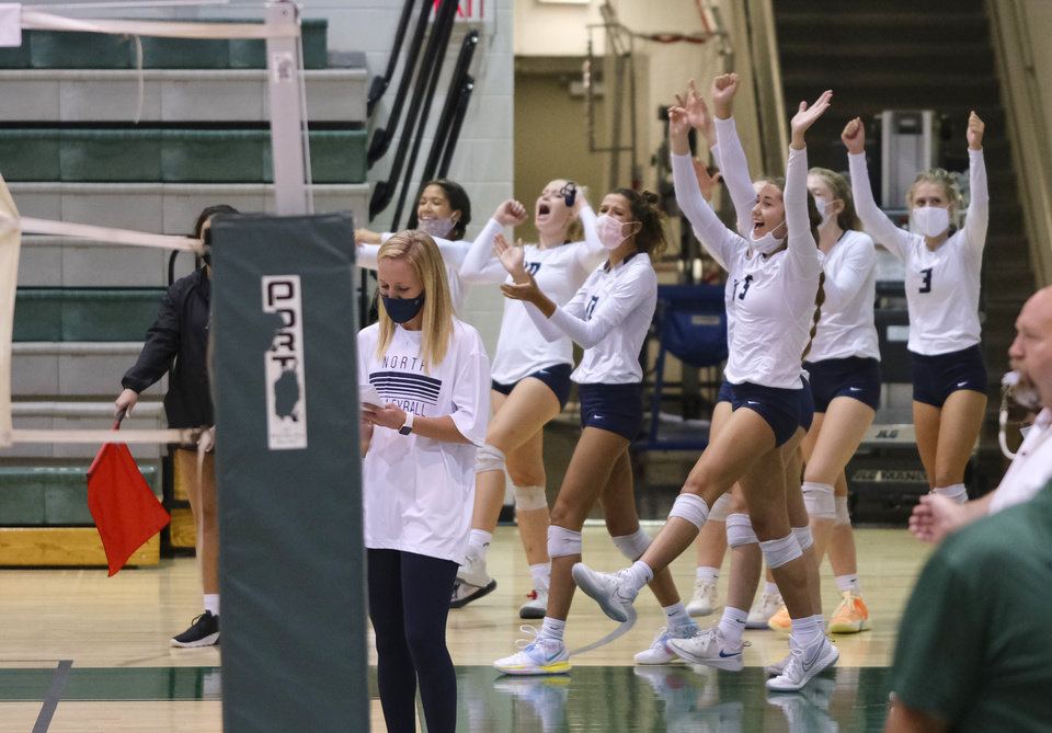 Photo - Edmond North team celebrate a point at the Heather Harkness Memorial Volleyball Tournament at Edmond Santa Fe High School Saturday, September 12, 2020. [Doug Hoke/The Oklahoman]