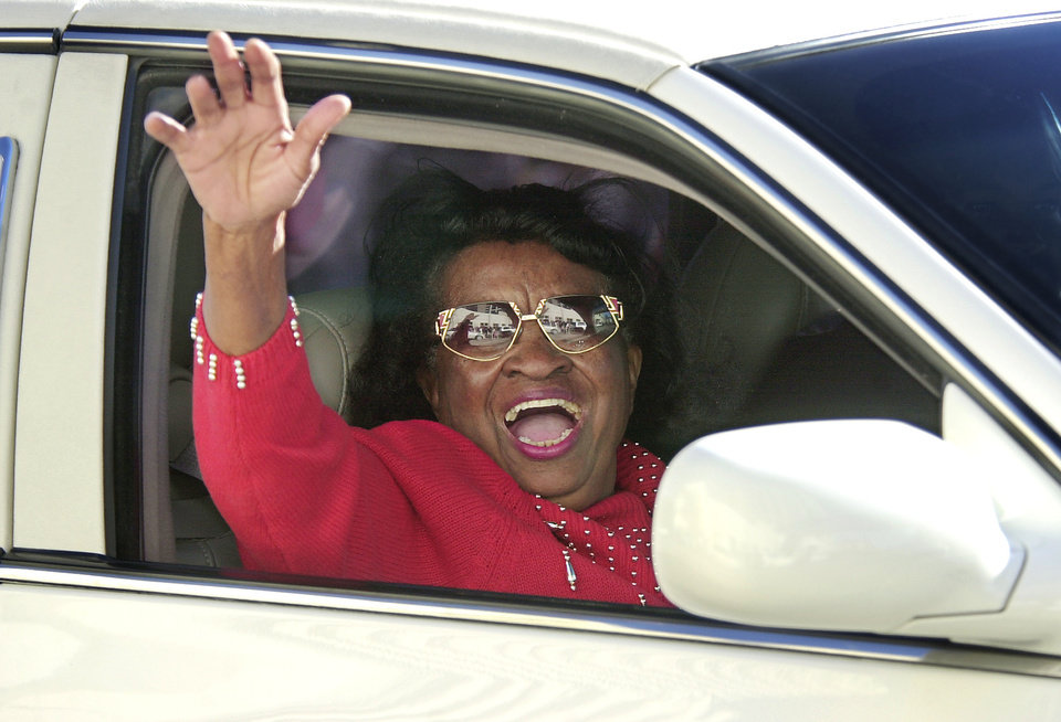 Photo - MARTIN LUTHER KING JR. DAY: Oklahoma civil rights pioneer Clara Luper smiles and waves to friends in the crowd along Monday afternoon's parade route celebrating the birth of Martin Luther King, Jr.  Staff photo by Jim Beckel.