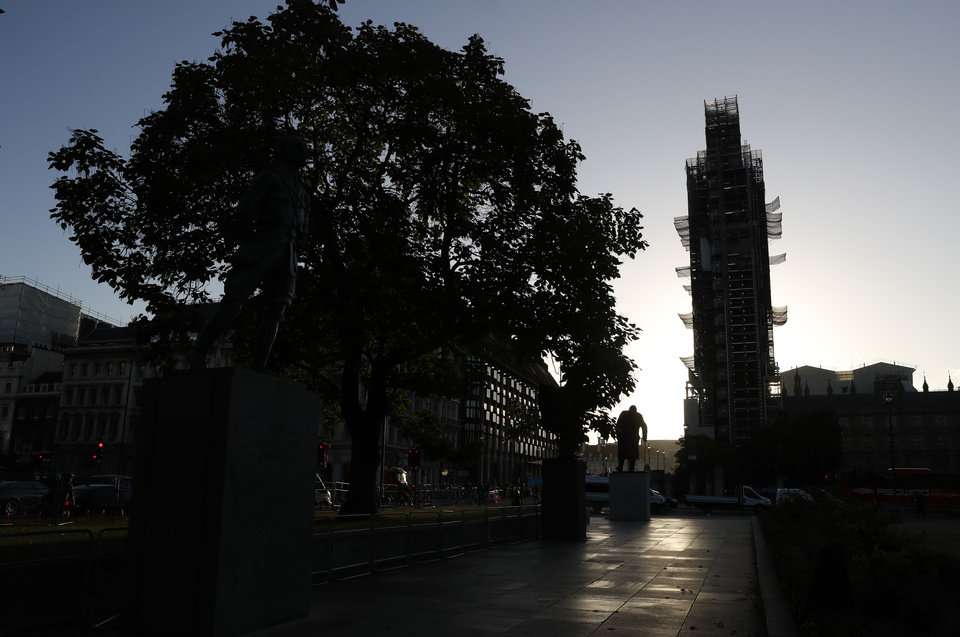 Photo -  The statue of former British Prime Minister Winston Churchill silhouetted against the sky with the Queen Elizabeth II tower of the Houses of Parliament in the background in the early morning in London, Thursday, Sept. 12, 2019. (AP Photo/Alastair Grant)