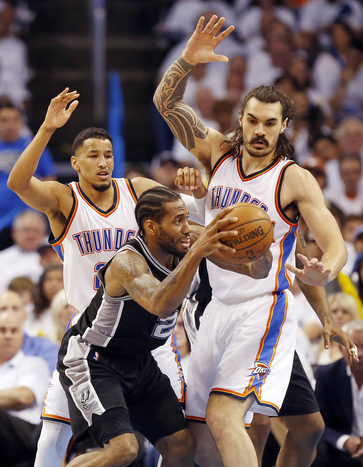 Photo - Oklahoma City's Andre Roberson (21), left, and Steven Adams (12) defend San Antonio's Kawhi Leonard during Game 4 of the Western Conference semifinals between the Oklahoma City Thunder and the San Antonio Spurs in the NBA playoffs at Chesapeake Energy Arena in Oklahoma City on Sunday. Oklahoma City won 111-97. (Photo by Nate Billings, The Oklahoman)