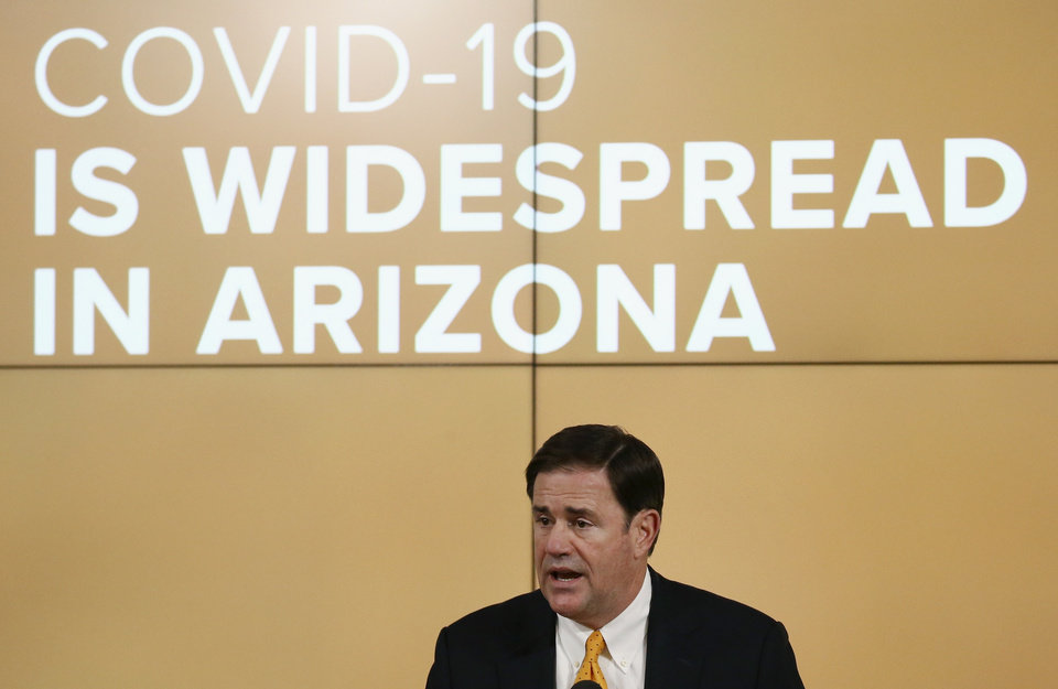 Photo -  Arizona Republican Gov. Doug Ducey speaks about the latest coronavirus data at a news conference Thursday, June 25, 2020, in Phoenix. (AP Photo/Ross D. Franklin, Pool)