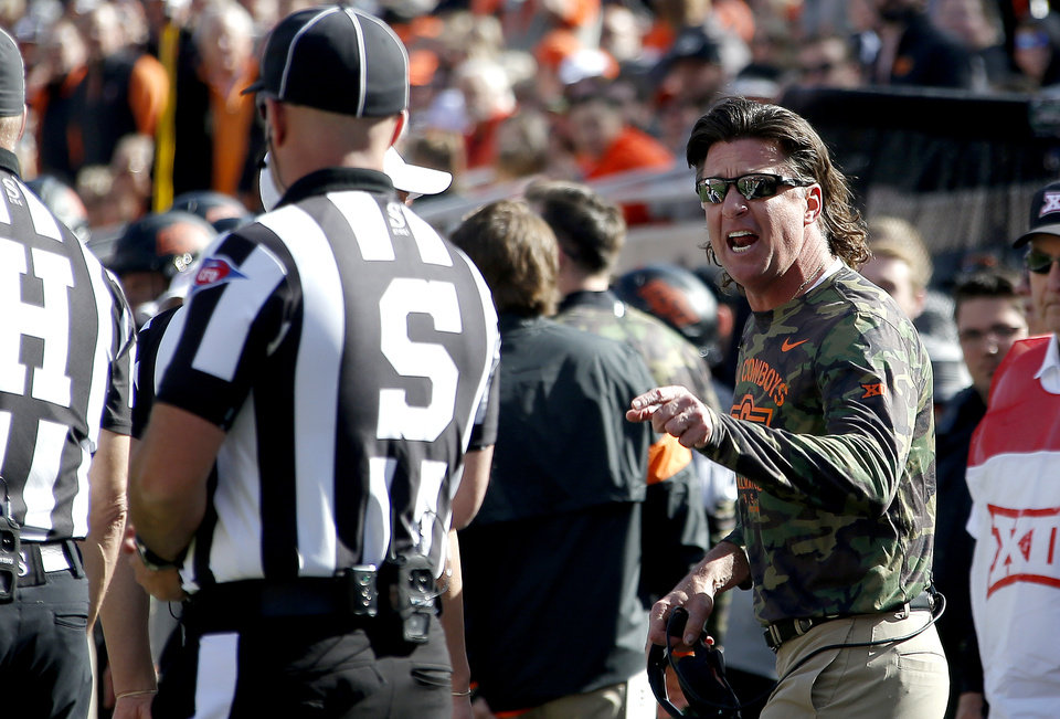 Photo - Oklahoma State head coach Mike Gundy argues for a call in the first quarter during the college football game between the Oklahoma State University Cowboys and the Kansas Jayhawks at Boone Pickens Stadium in Stillwater, Okla., Saturday, Nov. 16, 2019. OSU won 31-13. [Sarah Phipps/The Oklahoman]