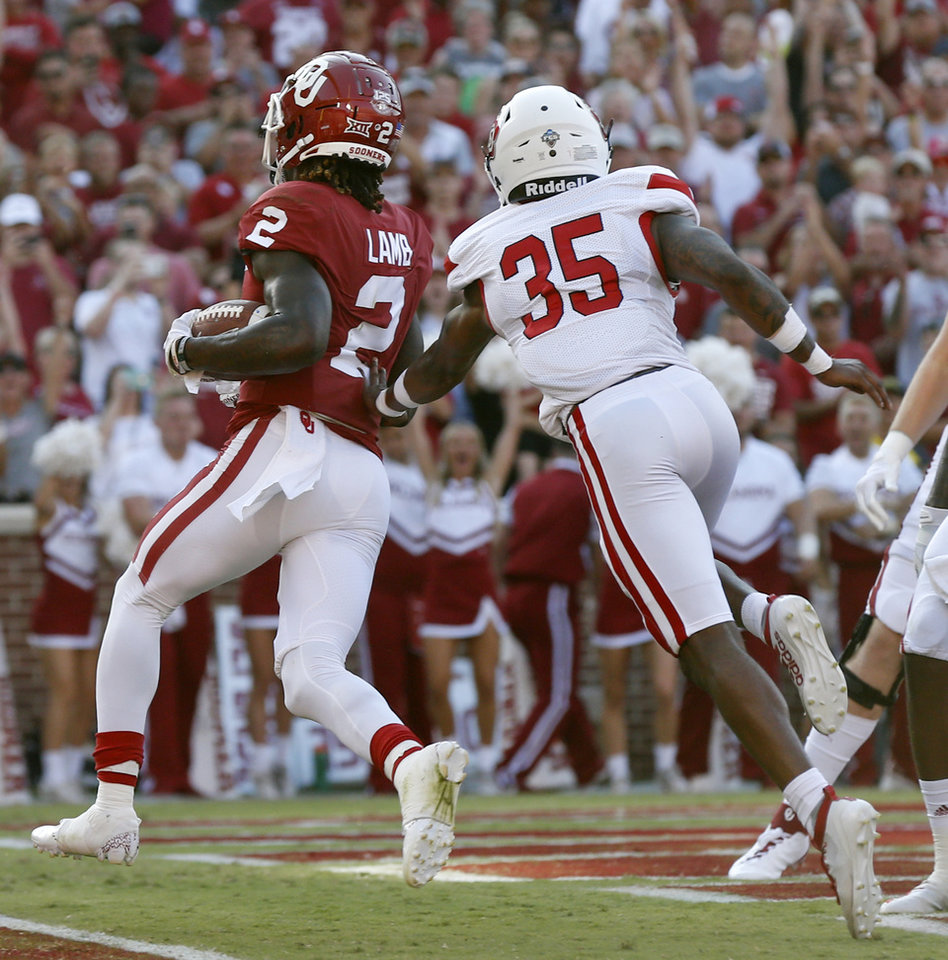 Photo - Oklahoma's CeeDee Lamb (2) scores a touchdown in front of South Dakota's Bakhari Goodson (35) in the first quarter during a college football game between the Oklahoma Sooners (OU) and South Dakota Coyotes at Gaylord Family - Oklahoma Memorial Stadium in Norman, Okla., Saturday, Sept. 7, 2019. [Nate Billings/The Oklahoman]