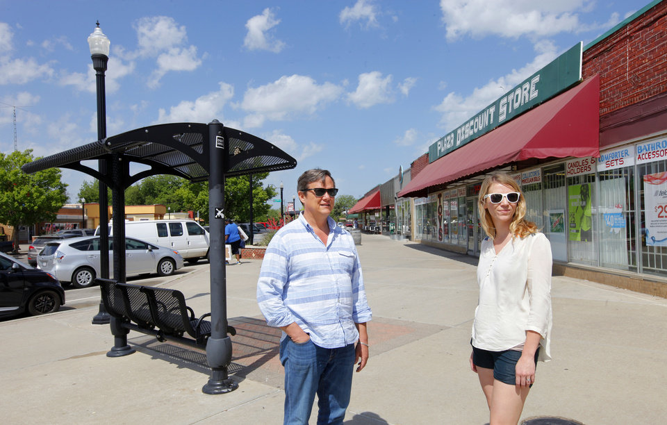 Photo -  Developer Steve Mason and Kristen Vails, executive director of the Plaza District Association, discuss the future of the a shopping center in the 1700 block of NW 16 in the Plaza District. PHOTO BY PAUL SOUTHERLAND, THE OKLAHOMAN   PAUL B. SOUTHERLAND -  PAUL B. SOUTHERLAND