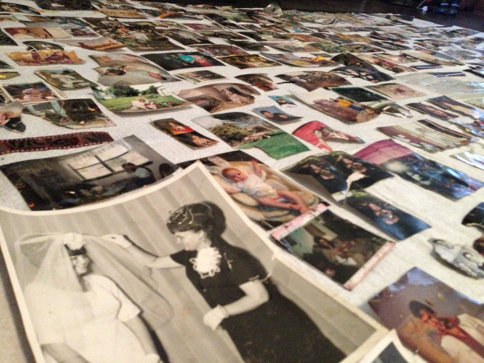 Photo - Photographer Amy Pierce has a collection of photos at her studio that turned up after Monday's tornado in Moore. Pierce found most of the photos among storm debris. She will keep the photos at her studio for storm victims to view and claim. PHOTO PROVIDED BY AMY PIERCE