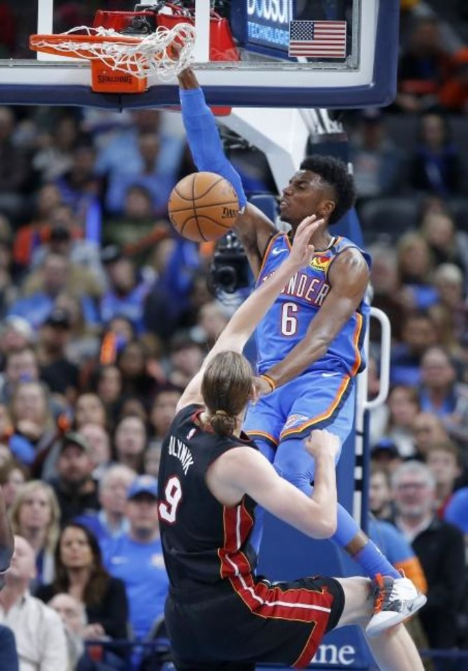 Photo -  Oklahoma City's Hamidou Diallo dunks the basketball over Miami's Kelly Olynyk during Friday's game at Chesapeake Energy Arena. [Bryan Terry/The Oklahoman]