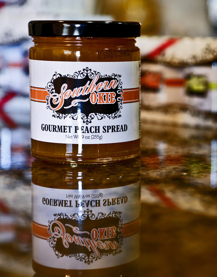 Photo -  Southern Okie Gourmet Peach Spread is seen at Gina Hollingsworth's home in Edmond. [Photo by Chris Landsberger, The Oklahoman]