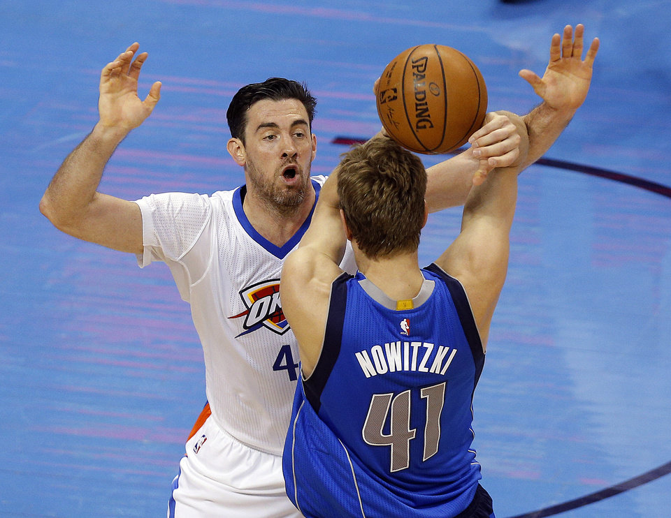 Photo - Oklahoma City's Nick Collison (4) defends against Dallas' Dirk Nowitzki (41) during Game 2 in the first round of the NBA playoffs between the Oklahoma City Thunder and the Dallas Mavericks at Chesapeake Energy Arena in Oklahoma City, Monday, April 18, 2016. Photo by Sarah Phipp, The Oklahoman