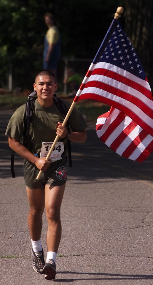 Photo - Andy Payne Memorial Marathon at Lake Overholser. Marathon runner Pvt. Roberto Orzeo, a Marine from Little Rock, Arkansas, ran the entire marathon while carrying an American flag in honor of Memorial Day.