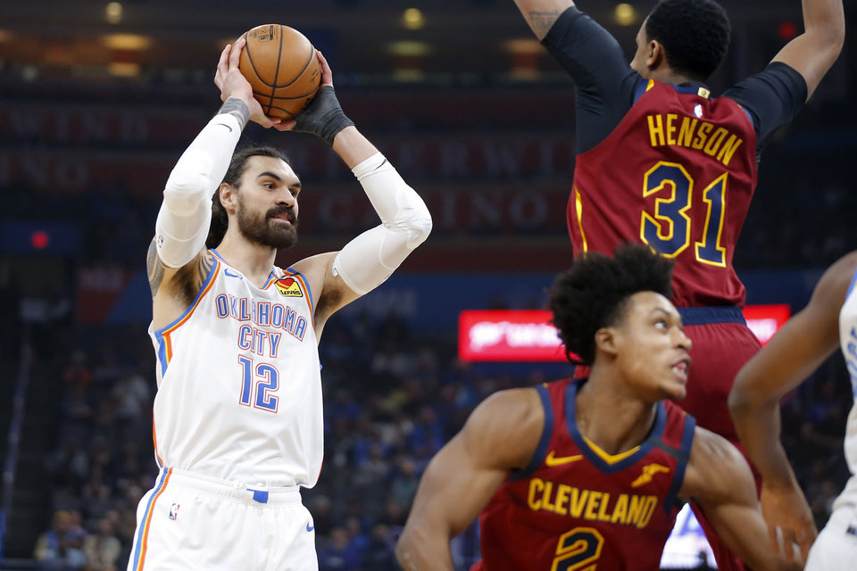 Photo - Oklahoma City's Steven Adams (12) passes the ball during an NBA basketball game between the Oklahoma City Thunder and the Cleveland Cavaliers at Chesapeake Energy Arena in Oklahoma City, Wednesday, Feb. 5, 2020. [Bryan Terry/The Oklahoman]