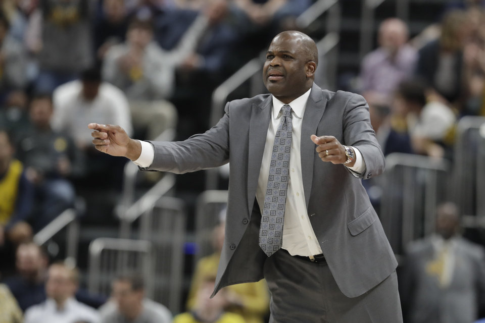 Photo - Indiana Pacers head coach Nate McMillan calls a play during the second half of an NBA basketball game against the Oklahoma City Thunder, Thursday, March 14, 2019, in Indianapolis. Indiana won 108-106. (AP Photo/Darron Cummings)