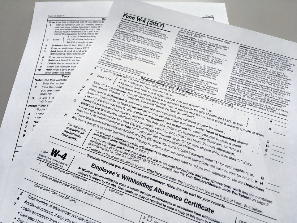 Photo - This Feb. 1, 2018 file photo shows an IRS W-4 form in New York. (AP Photo/Barbara Woike, File)