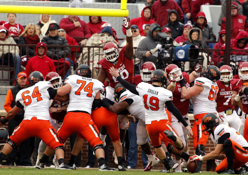 Photo - Cowboy's Ben Grogan (19) kicks an extra point during a Bedlam college football game between the University of Oklahoma Sooners (OU) and the Oklahoma State Cowboys (OSU) at Gaylord Family-Oklahoma Memorial Stadium in Norman, Okla., on Saturday, Dec. 6, 2014. Photo by Steve Sisney, The Oklahoman