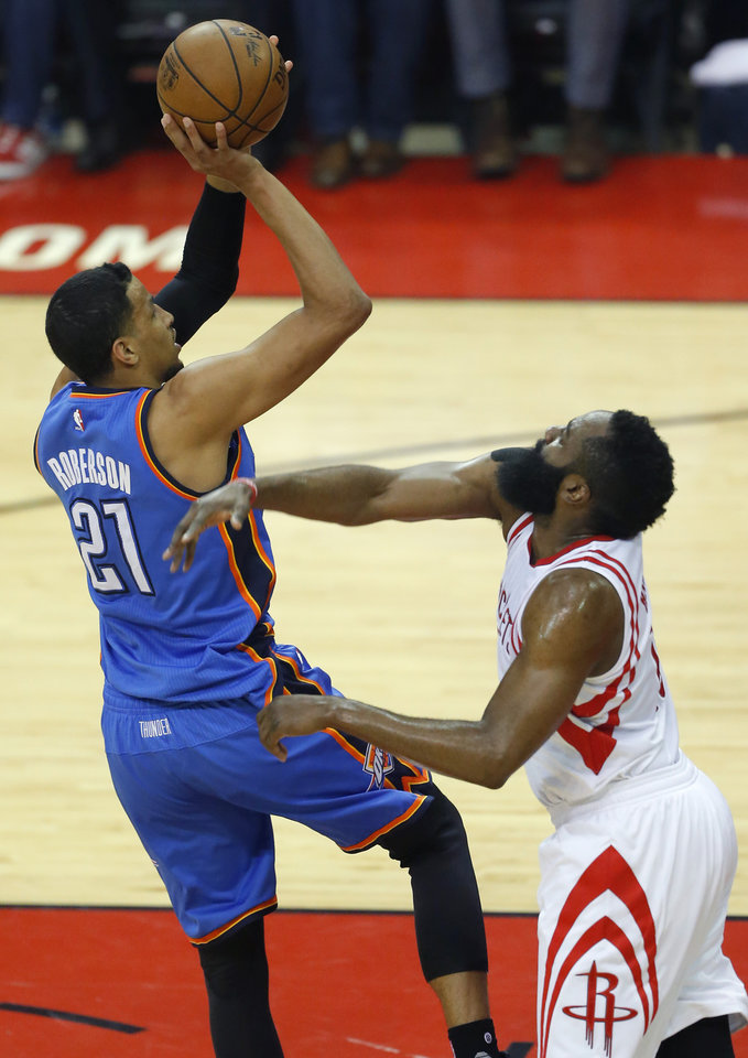 Photo - Oklahoma City's Andre Roberson (21) shoots over Houston's James Harden (13) during Game 2 in the first round of the NBA basketball playoffs between the Oklahoma City Thunder and the Houston Rockets at the Toyota Center in Houston, Texas,  Wednesday, April 19, 2017.  Photo by Sarah Phipps, The Oklahoman