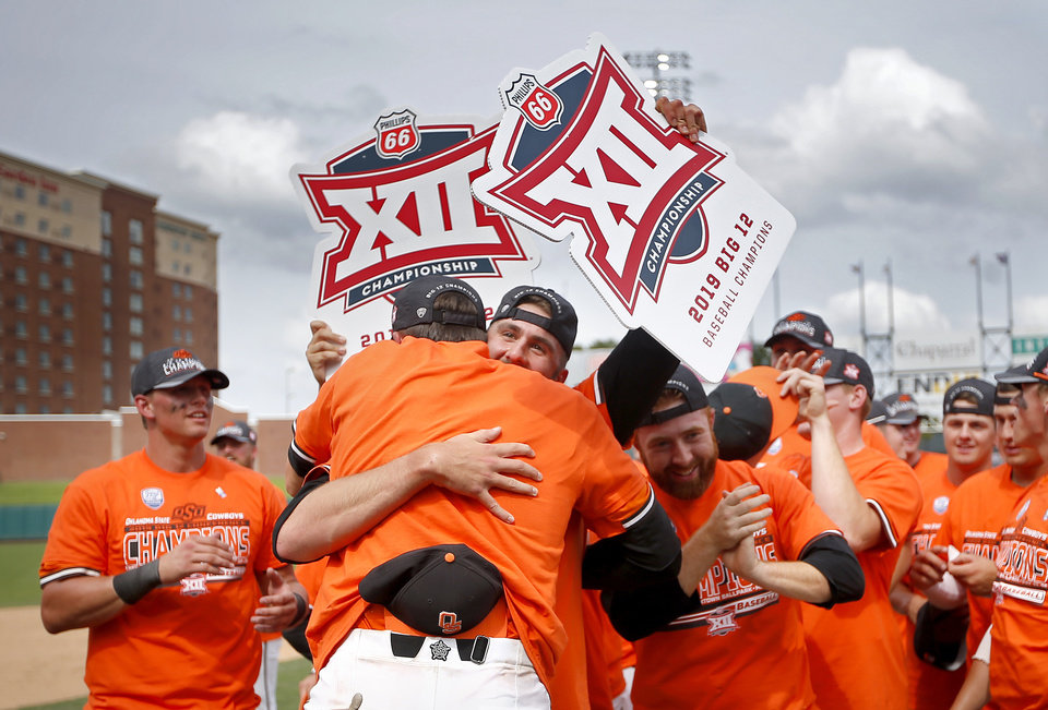 Photo - Oklahoma State celebrates the Big 12 baseball championship over West Virginia at the Chickasaw Bricktown Ballpark in Oklahoma City, Sunday, May 26, 2019.  [Sarah Phipps/The Oklahoman]