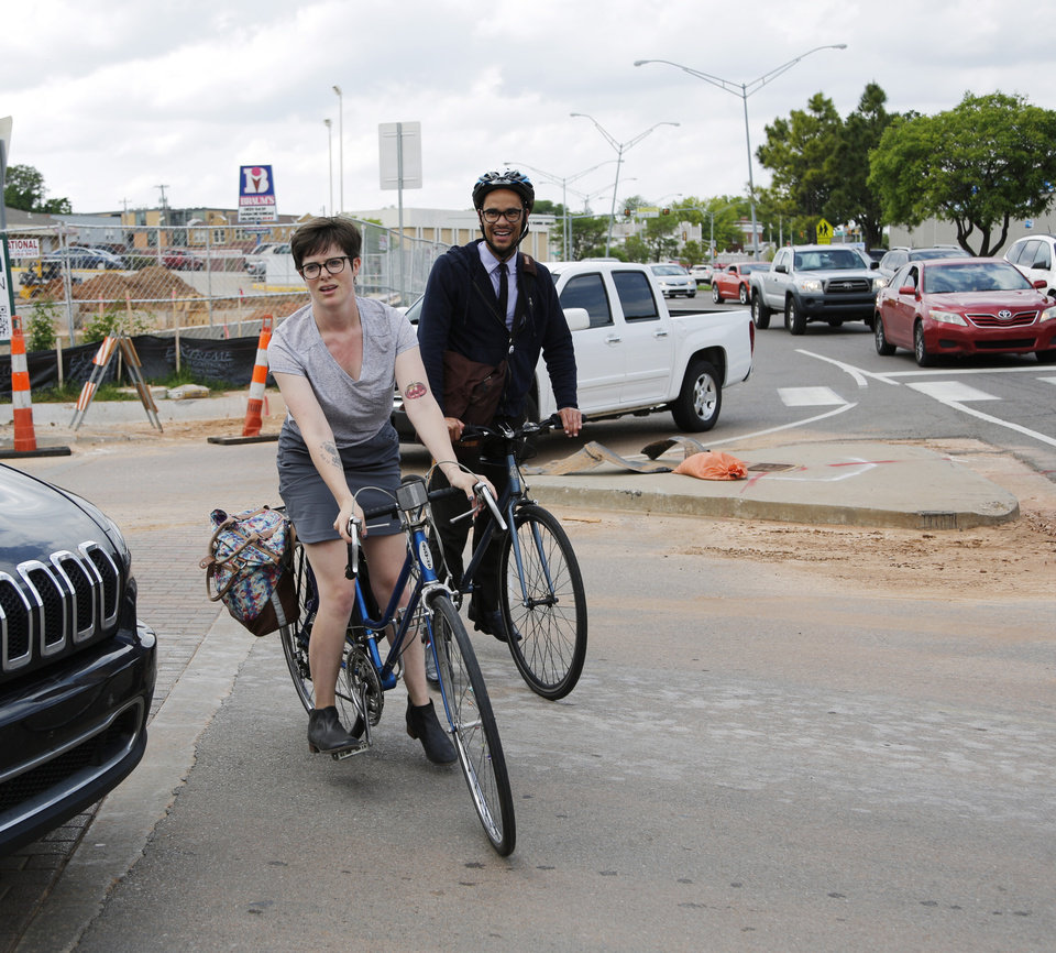 Photo - Oklahoma City council members, Jobeth Hamon and James Cooper ride up to 16th and Classen Boulevard to join the riders. Dozens of bicyclists ride along Classen Boulevard Tuesday, May 7, 2019, to highlight the need for better bike lanes, stopping at 16th and Classen Blvd. where a ghost bike memorial for Chad Epley who was killed at the intersection while riding home after work.  Photo by Doug Hoke.