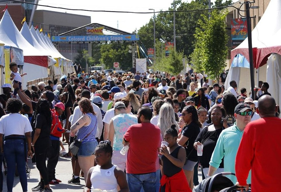 Photo - People crowd the Colcord Drive food row at the Festival of the Arts in Bicentennial Park in downtown Oklahoma City, Sunday, April 28, 2019. [Doug Hoke/The Oklahoman Archives]