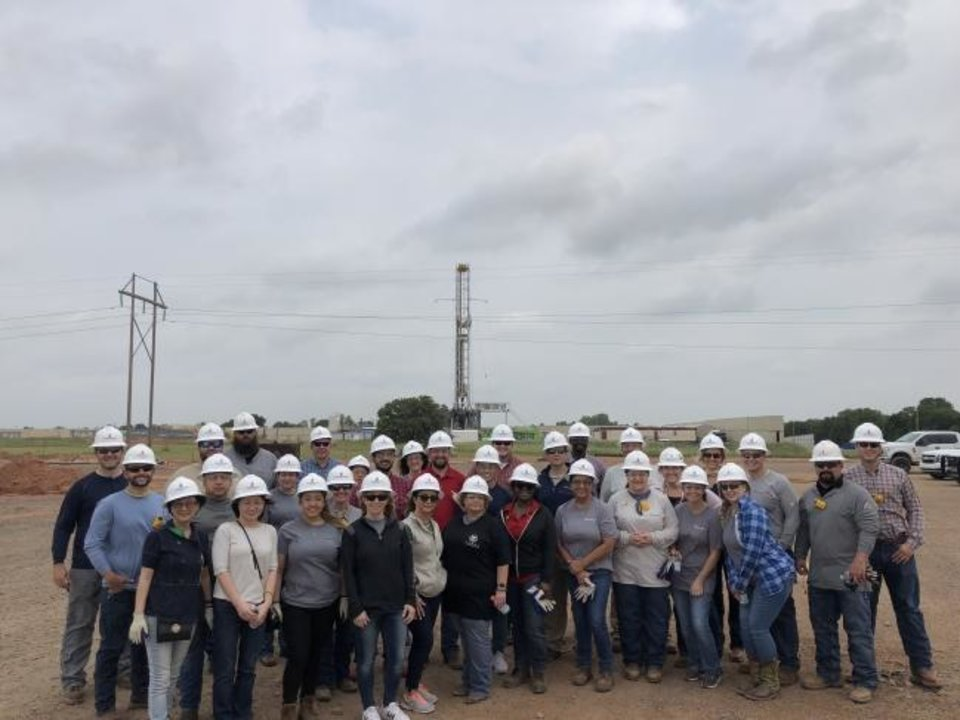 Photo -  EOG Resources employees pose for a group picture on a recent field trip. [PROVIDED]