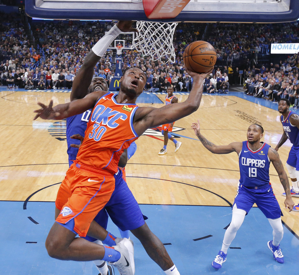 Photo - Oklahoma City's Deonte Burton (30) goes to the basket during an NBA basketball game between the Oklahoma City Thunder and the LA Clippers at Chesapeake Energy Arena in Oklahoma City, Sunday, Dec. 22, 2019. Oklahoma City won 118-112. [Bryan Terry/The Oklahoman]