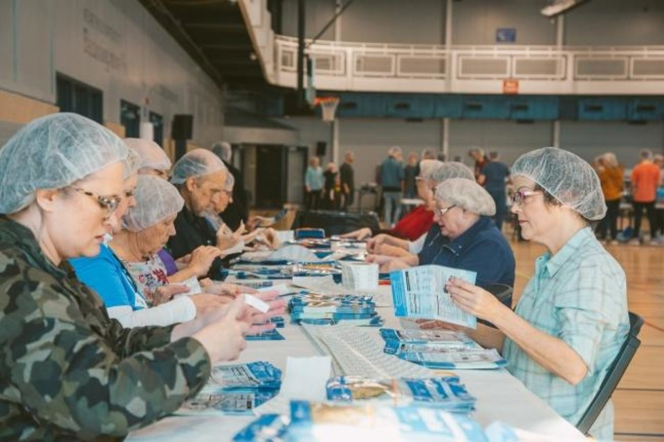 Photo -  Members of Bethany First Church of the Nazarene pack meals as part of a Feed My Starving Children MobilePack event to pack for children around the world. [Photo provided]