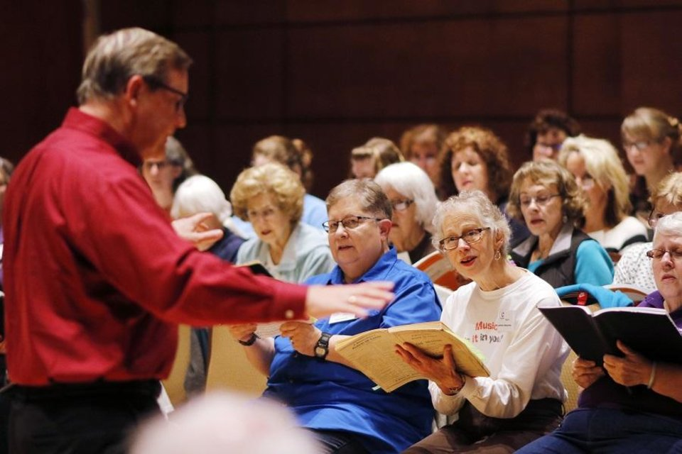 Photo - Artistic Director Randi Von Ellefson leads rehearsals for Canterbury Voices Monday, November 13, 2017. [Photo by Doug Hoke/The Oklahoman Archives]
