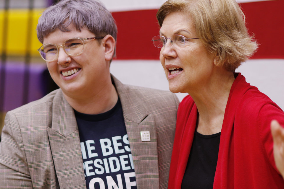 Photo - A.C. Facci, Warren Organizational Director for Oklahoma poses with Sen. Elizabeth Warren after a rally  in Oklahoma City at Northwest Classen High School, her alma mater, Sunday, December 22, 2019. [Photo by Doug Hoke/The Oklahoman]