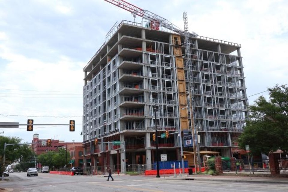 Photo -  Construction continues on Bricktown's first full-service hotel, a 10-story Renaissance Hotel, set to open by early 2021 at the southeast corner of Sheridan and Oklahoma Avenues.  [DOUG HOKE/THE OKLAHOMAN]