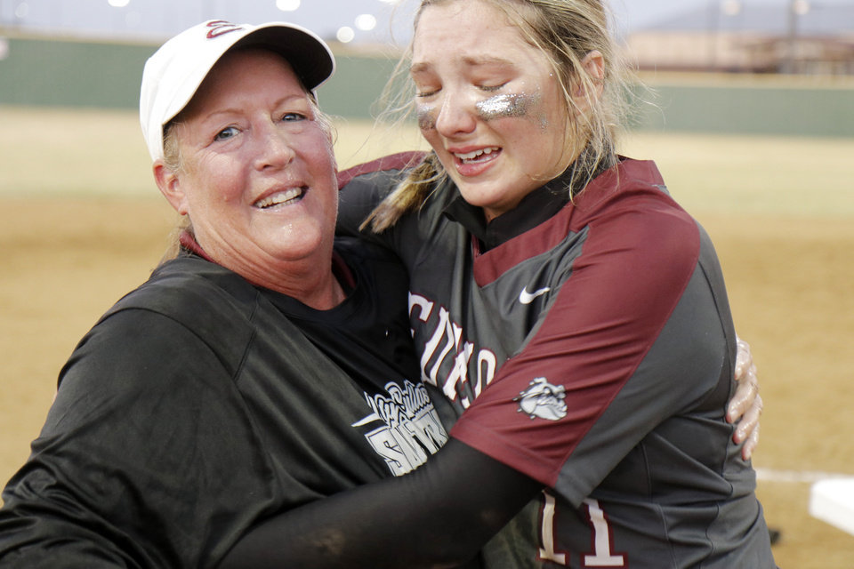 Photo - Edmond coach Janet Chartney hugs pitcher Jim Dickson during the 6A Fast Pitch Championship game between Edmond Memorial and Owasso at the Ball Fields at Firelake in Shawnee, Saturday, October 19, 2019. [Doug Hoke/The Oklahoman]