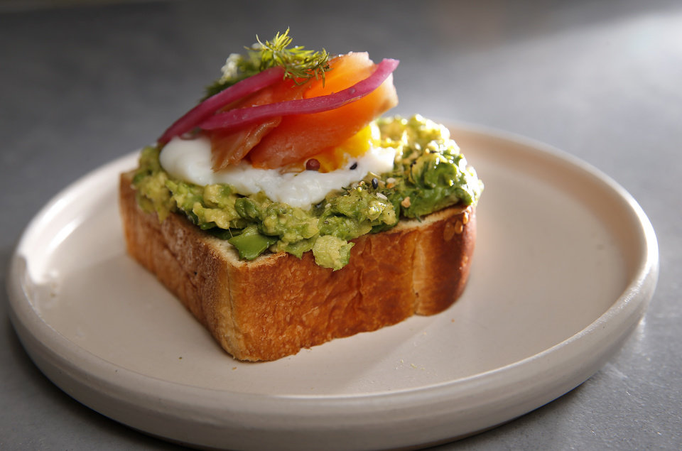 Photo -  Avocado & Egg Toast with smoked salmon from The Kitchen at Commonplace Books in Oklahoma City. [Photo by Sarah Phipps, The Oklahoman]