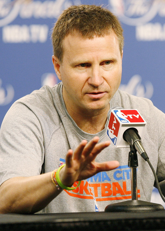 Photo - Oklahoma City head coach Scott Brooks answers questions during media and practice day for the NBA Finals between the Oklahoma City Thunder and the Miami Heat at the Chesapeake Energy Arena in Oklahoma City, Monday, June 11, 2012. Photo by Nate Billings, The Oklahoman