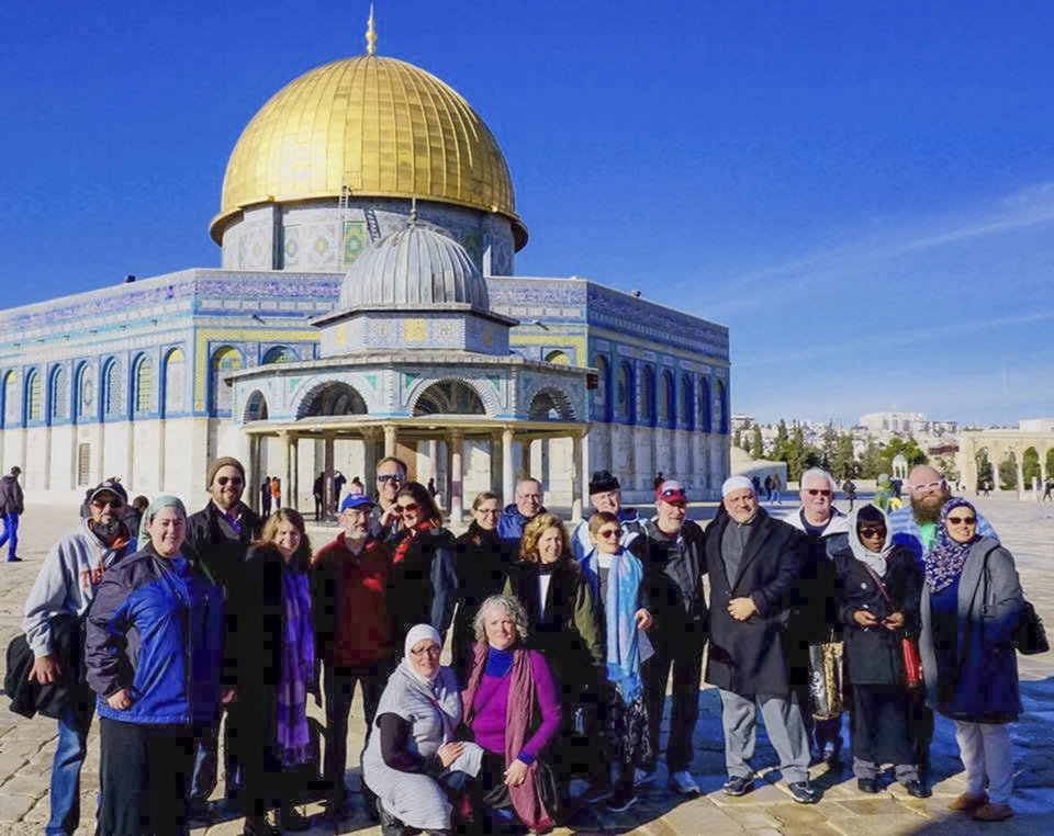 Photo -  The Oklahoma Religions United group poses for a picture outside the Dome of the Rock, an Islamic shrine in the Old City of Jerusalem. [Photo by Evan Taylor]