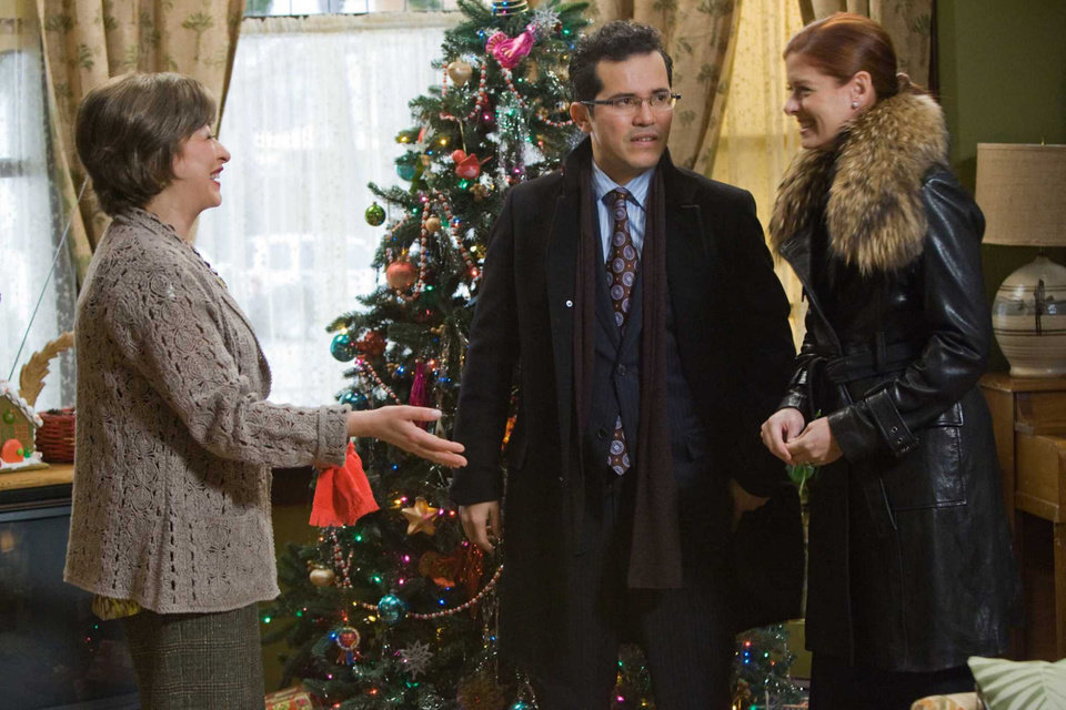 Photo - From left, Elizabeth Pena, John Leguizamo and Debra Messing star in