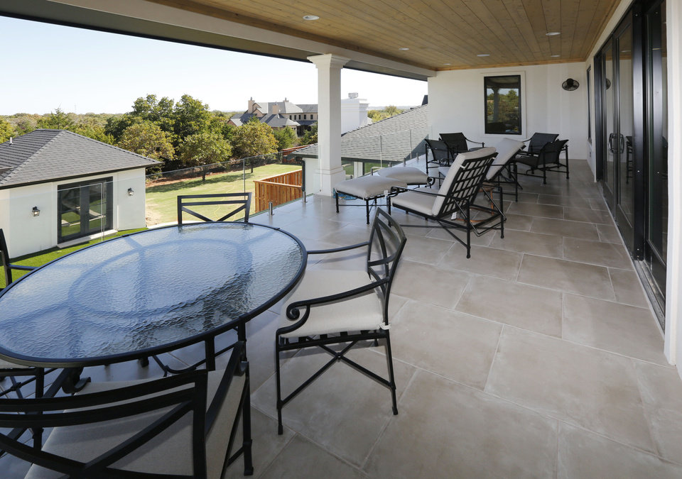 Lovely Second story deck in the Rader Building Co home at Deerfield Drive PHOTO BY PAUL HELLSTERN THE OKLAHOMAN
