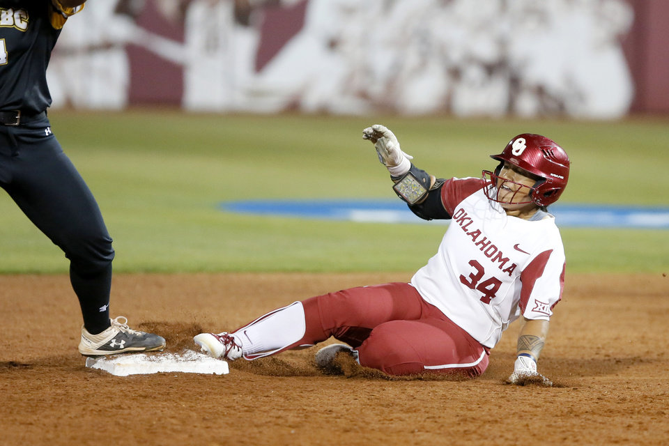 Photo - Oklahoma's Falepolima Aviu (34) slides to second in the fourth inning of the Norman Regional NCAA softball tournament game between the University of Oklahoma (OU) and UMBC in Norman, Okla., Friday, May 17, 2019. Oklahoma won 12-0.  [Bryan Terry/The Oklahoman]