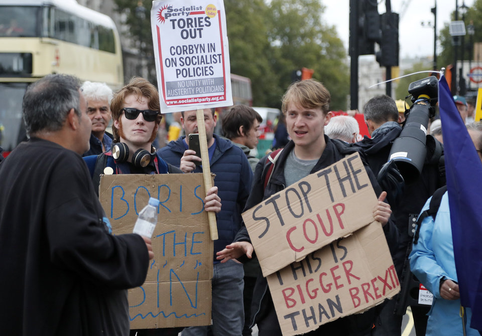 Photo -  Protesters argue Monday in parliament square in London. British Prime Minister Boris Johnson voiced optimism Monday that a new Brexit deal can be reached so Britain leaves the European Union by Oct. 31. [Frank Augstein/the associated press]