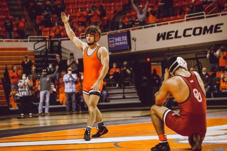 Photo -  Oklahoma State 133-pounder Daton Fix celebrates after pinning OU's Tony Madrigal in the Bedlam dual on Sunday at Gallagher-Iba Arena in Stillwater. [BRUCE WATERFIELD/OSU ATHLETICS]