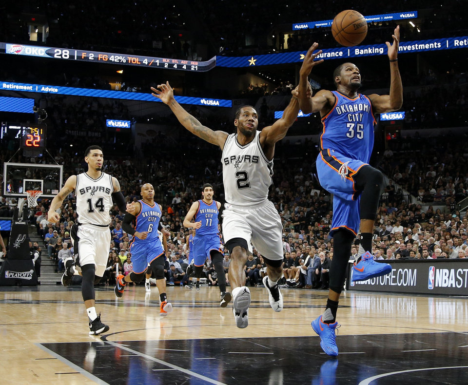 Photo - Oklahoma City's Kevin Durant (35) is fouled by San Antonio's Kawhi Leonard (2) during Game 5 of the second-round series between the Oklahoma City Thunder and the San Antonio Spurs in the NBA playoffs at the AT&T Center in San Antonio, Tuesday, May 10, 2016. Photo by Bryan Terry, The Oklahoman