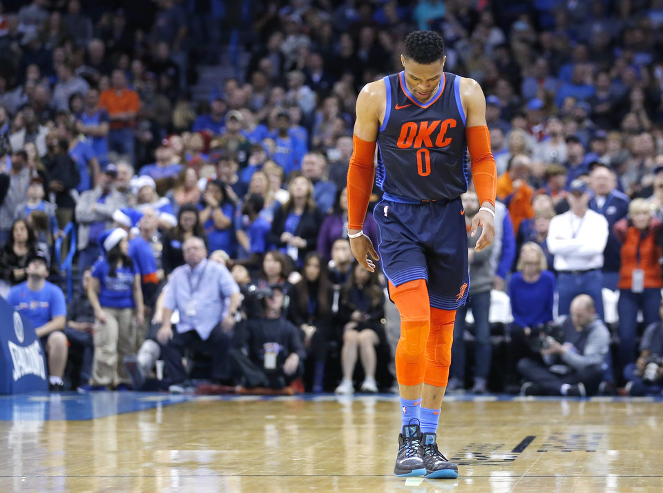 a8fc3205c077 Oklahoma City s Russell Westbrook (0) walks off the court after fouling out  of the game during the NBA game between the Oklahoma City Thunder and the  ...