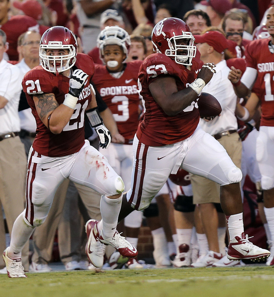 Photo - OU's Tom Wort (21) runs with OU's Casey Walker (53) who returns a fumble during the college football game between the University of Oklahoma Sooners (OU) and the University of Kansas Jayhawks (KU) at Gaylord Family-Oklahoma Memorial Stadium on Saturday, Oct. 20th, 2012, in Norman, Okla. Photo by Chris Landsberger, The Oklahoman